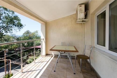 Стандартный двухместный номер с балконом и видом на море-3